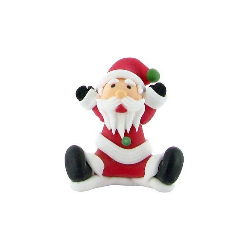 Père Noël assis bras levés en sucre