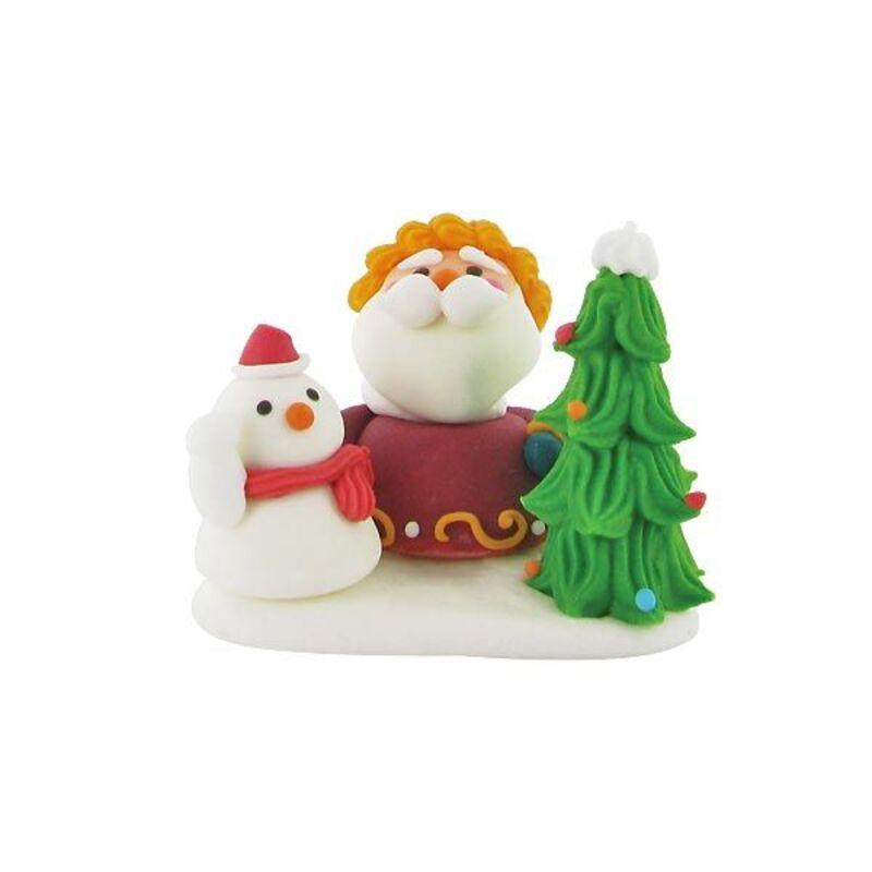 Père Noël derrière un sapin en sucre
